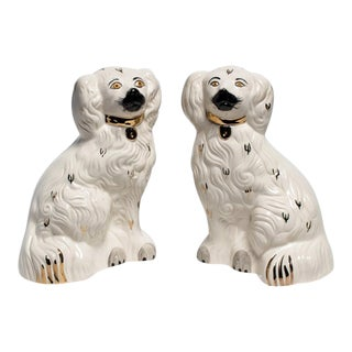 WHITE AND GOLD STAFFORDSHIRE DOGS