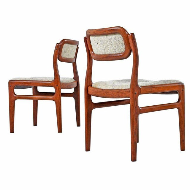 A set of four rosewood dining chairs, in the style of Niels O. Møller. The price listed is for all four chairs. The...