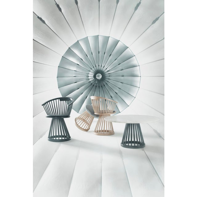 Originally a dramatic and sculptural take on a British design classic, Fan is available as a high back chair, dining...