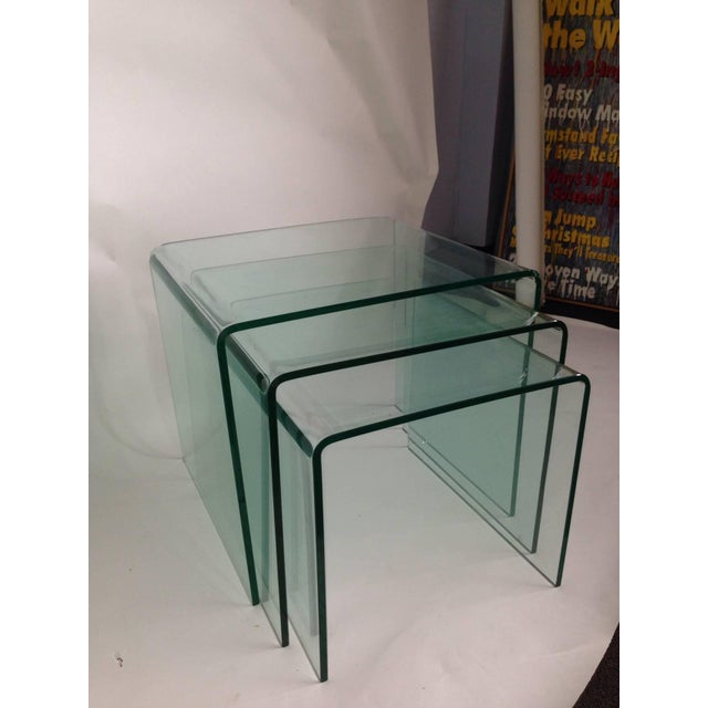 Made of tempered green glass, these nesting tables are wonderful together or apart. These are the real deal - not...