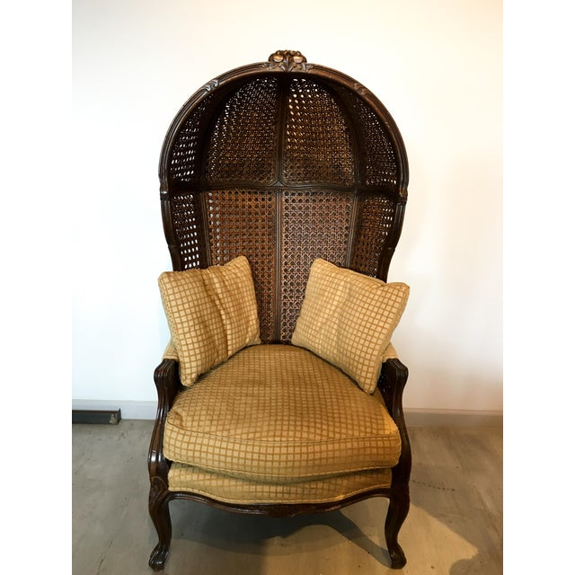 This is a stunning porter's chair made by Spanish designer Mariano Garcia. It features 20 panels of cane in excellent...