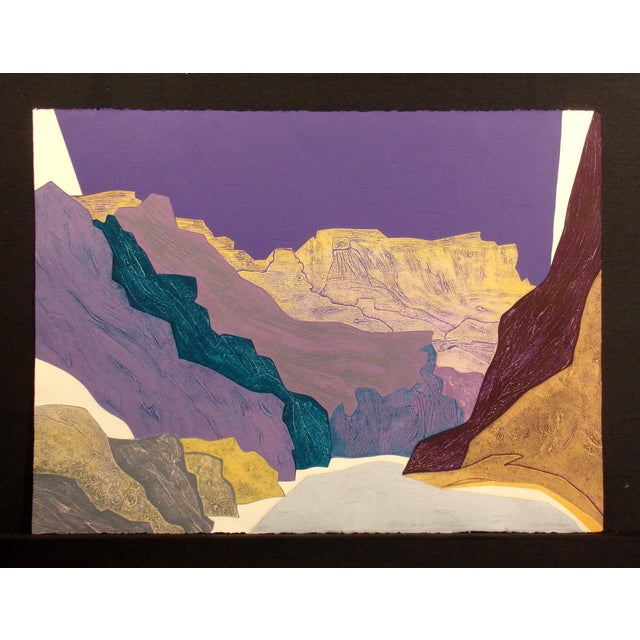 Very colorful hand signed limited edition collagraph etching of a southwestern canyon by Clare Romano. From the mid 1970s...