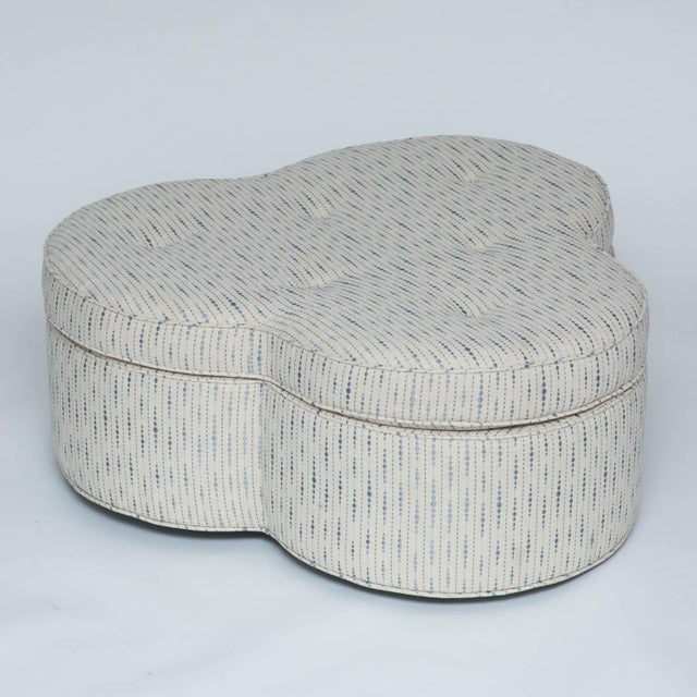 Newly upholstered ottoman with hidden wheels for ease of movement.
