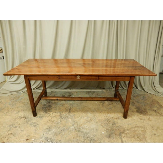 19th century French walnut farm table with H stretcher and one draw. Seats 8 and height from bottom of apron to floor is...