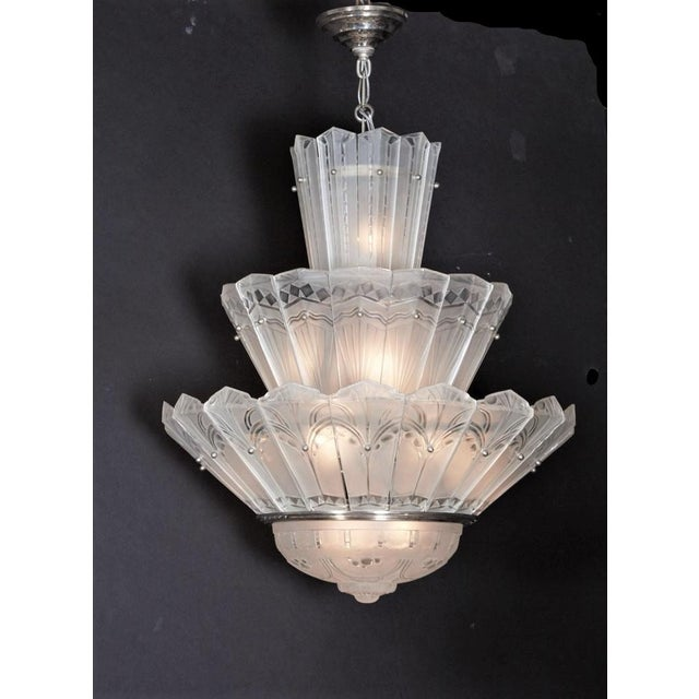 Fine and rare French Art Deco three-tier waterfall chandelier by Sabino. Forty-three frosted and polished molded art glass...