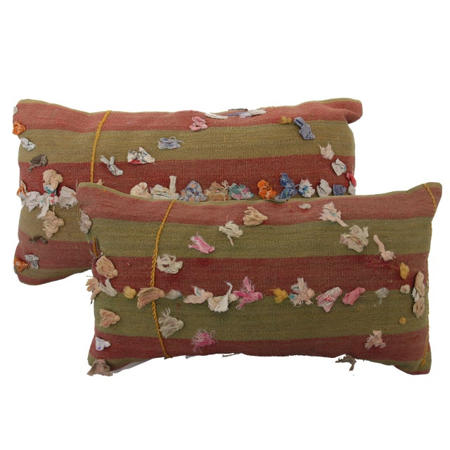 Cut from a vintage Turkish Tassle rug, these two pillows are unique and truly one-of-a-kind. The pillow has a zipper close...