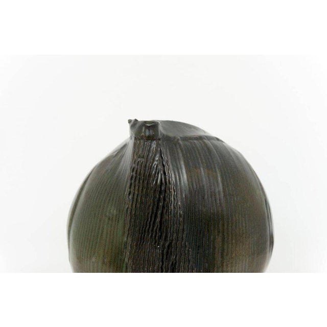 Dark green organic-form ceramic vase by Sassi Milici. Signed underside. Vallauris, France, circa 1970.