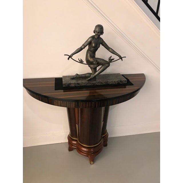 French Art Deco female sculpture on marble. Deco girl holding branch with birds playing. Adding the perfect deco decor to...