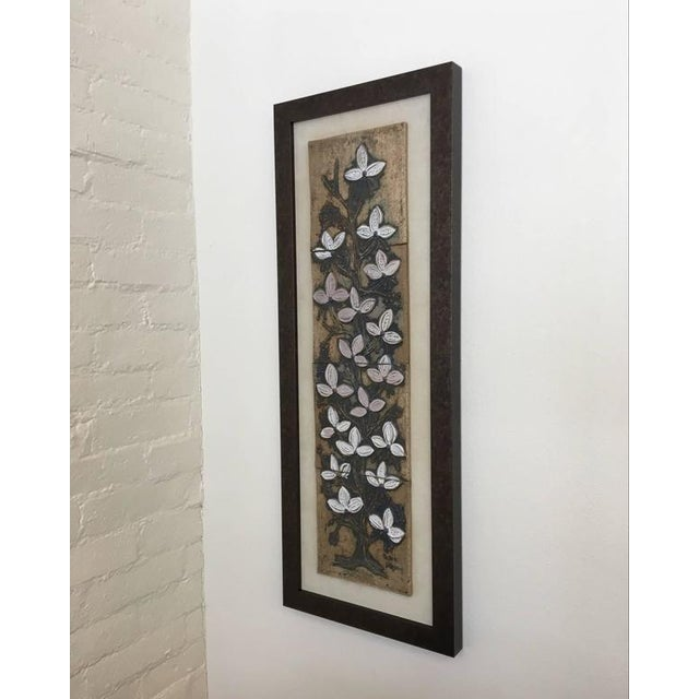 A large ceramic wall art of a beautiful flowering tree by California ceramicist Victoria Littlejohn. The flowers are...
