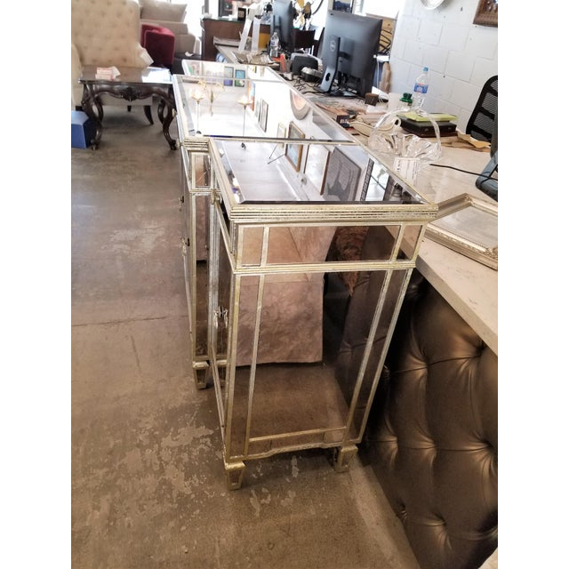 This is a very trendy and beautiful mirrored buffet. This buffet is sold AS IS: 2 mirror cracks, no shelves, wine rack...