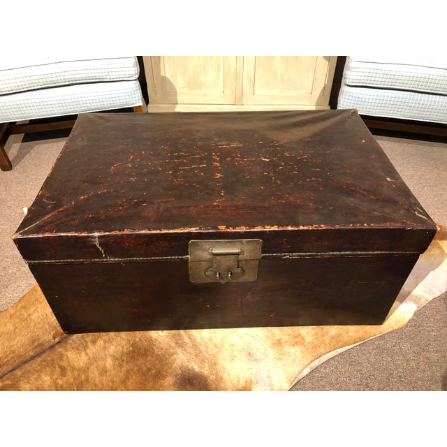 Antique Chinese brown leather trunk, c. 1820's. Great storage or coffee table.