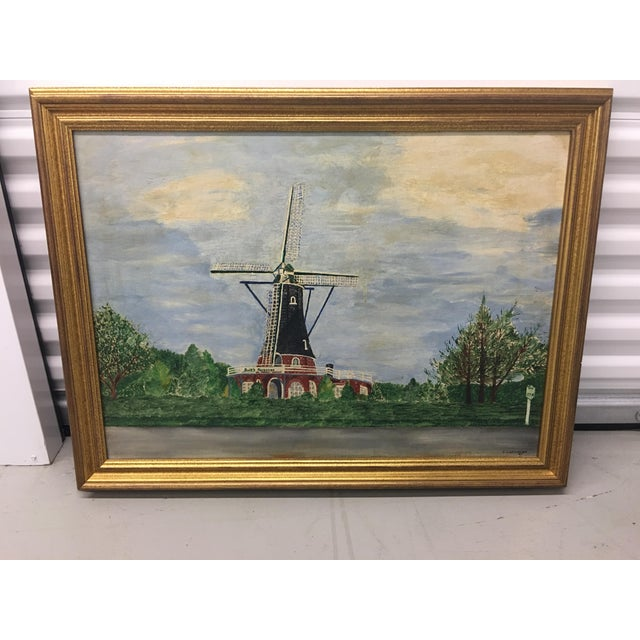 Beautiful vintage landscape painting featuring a windmill seen from a road. The road has a route marker NY 27A. The...