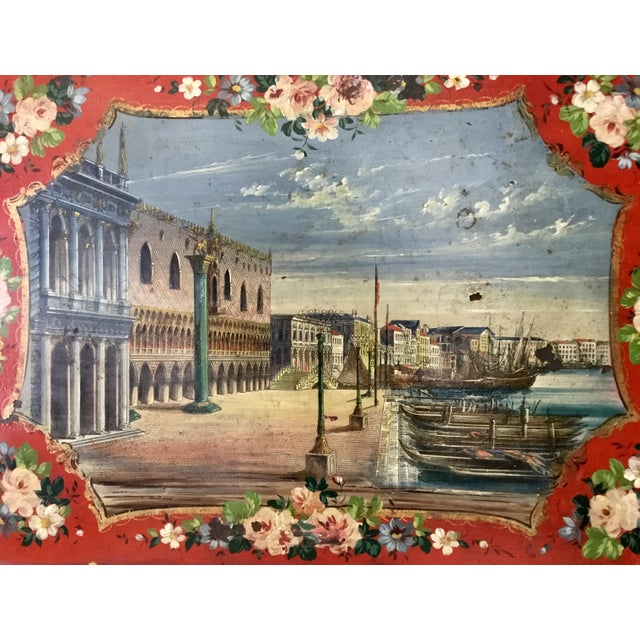 Beautifully and skillfully executed, this hand painted tole tray shows an idyllic afternoon in a charming 17th C. Italian...