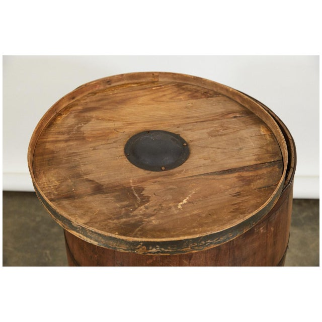 This nicely shaped wooden barrel has a shaker top and a great patina. A wonderful piece for a multitude of uses including...
