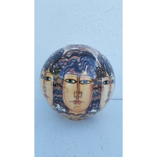 This is a unique and beautiful hand-made ceramic vase with hand-painted four women's faces around it. The art vase was...