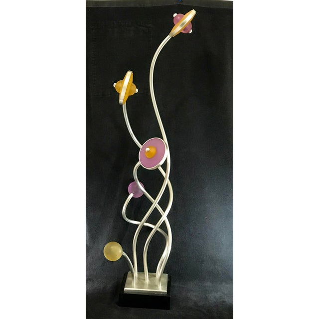 Large mid century metal and lucite abstract floral statement piece sculpture. Mounted on a wood plinth, this sculpture...