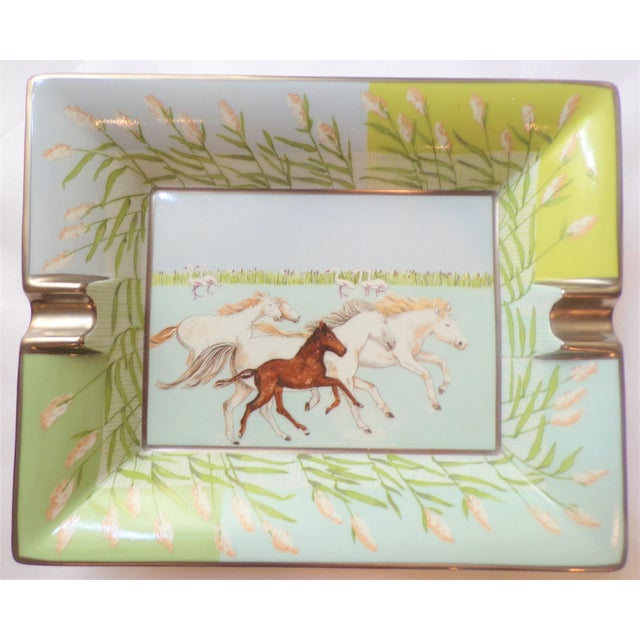 This is a vintage Hermes porcelain cigar tray circa. The design on the inside features beautiful brown and white wild...