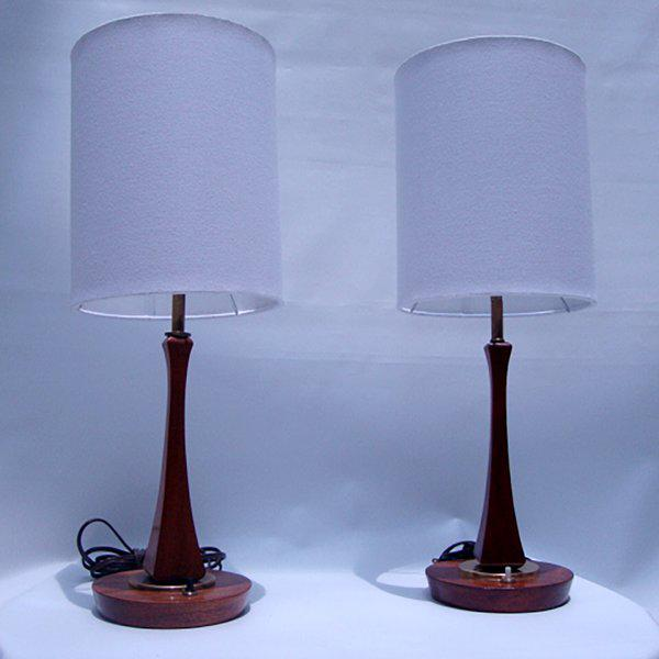 For your consideration a pair of sculptural table lamps constructed with solid mahogany wood and bronze accent details....