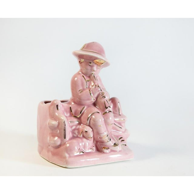 """""""Little boy blue come blow your horn."""" This vintage vase is a rose pink color with a boy and sheep figure on the front...."""