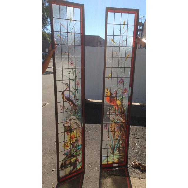 Very rare pair of French late 1880s/1890s painted and fired stained glass windows. The pair display a colorful and...