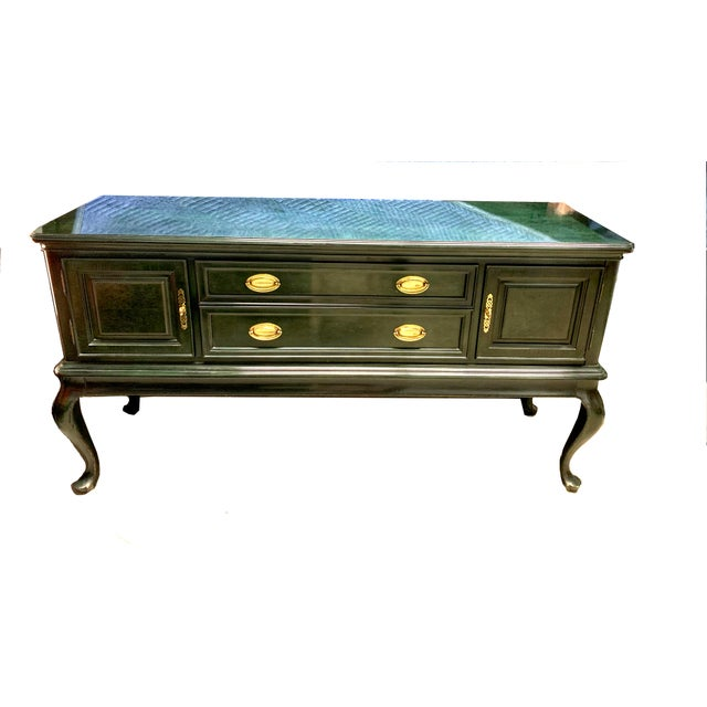 Truly a stunning piece! This beautiful server by Bernhardt is a rare find with it green high-shine, almost epoxy like...