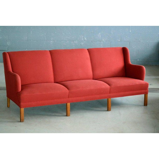 This very elegant and generously sized three-seat sofa was designed and made by the Danish Master Cabinetmaker, Frits...