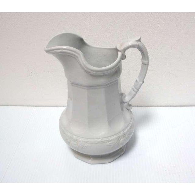 This 19th century English white ironstone pitcher/ ewer have a distinctive shape with an embossed fig leaf pattern banding...