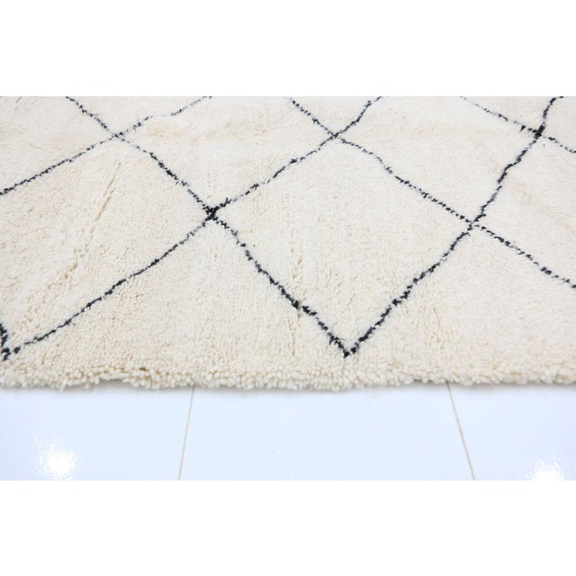 Beni Ourain - or Beni Ouarain - rugs are one of a kind rugs made by the Berber tribes of the Middle Atlas Mountains in...