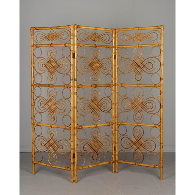 A Mid Century French Riviera three panel folding screen, or room divider, with sturdy handcrafted bamboo and rattan frame...