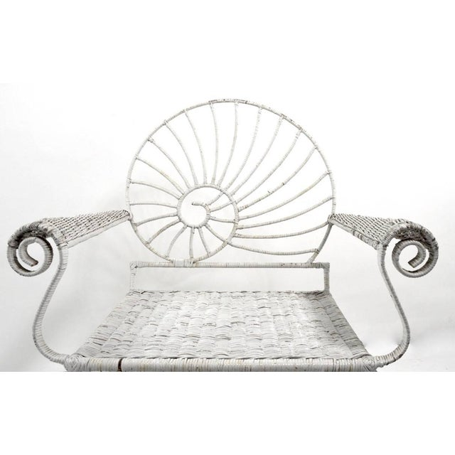Iron and wicker Nautilus Shell back lounge chair. This chair has a wicker wrapped iron frame, the wicker wrapping show...