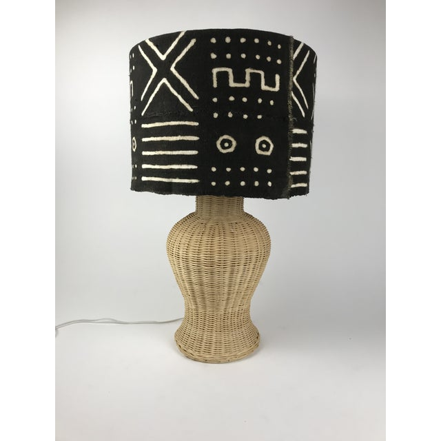 This is the perfect Boho lamp with a wicker ginger jar base paired with this custom authentic mud cloth drum shade....