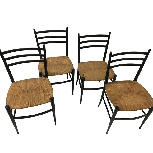 Chiavari. Vintage Rush Seat Ladder back Spinetto Chairs Inspired by Gio Ponti, these vintage Chiavari chairs were...