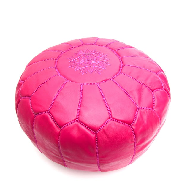 This eye-catching Atlas Pouf will lend an air of exotic majesty to your den or living room. Handcrafted in leather by...