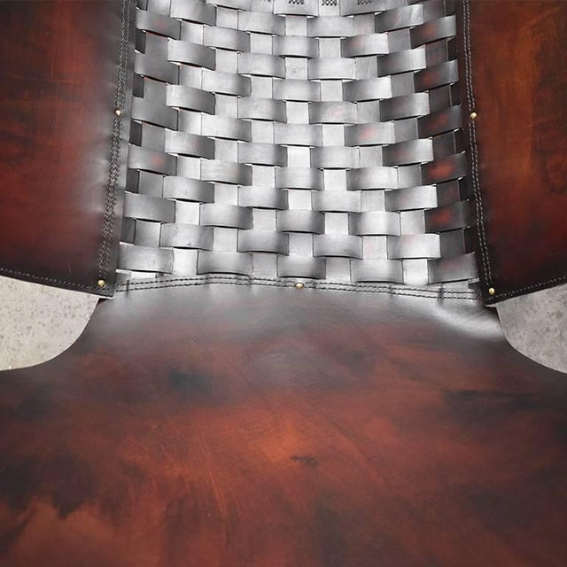 Pair of custom handmade Iron and leather sling chairs. Bases: The bases are hand forged in a beautiful patinated steel....