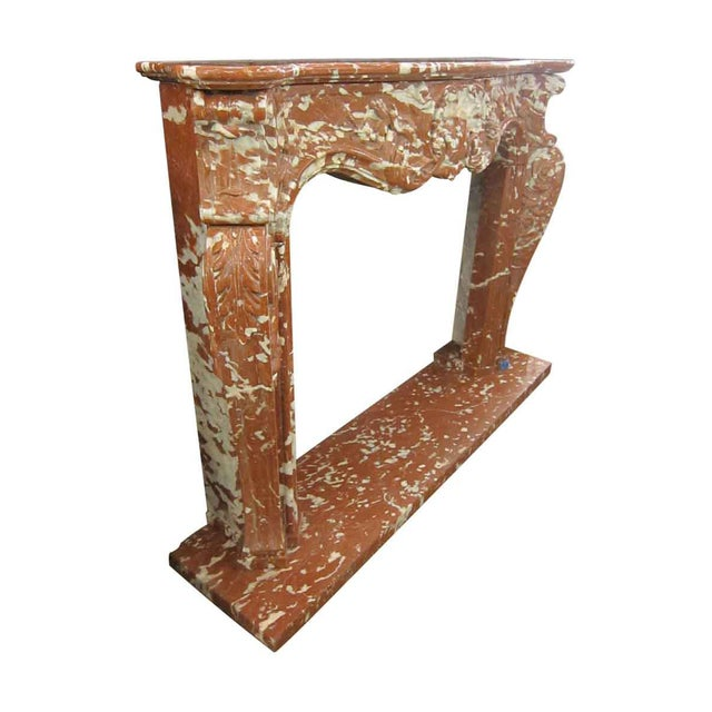 This mantel is from Italy and carved in the 1970s. It is a new replica of an original French mantel and never used.