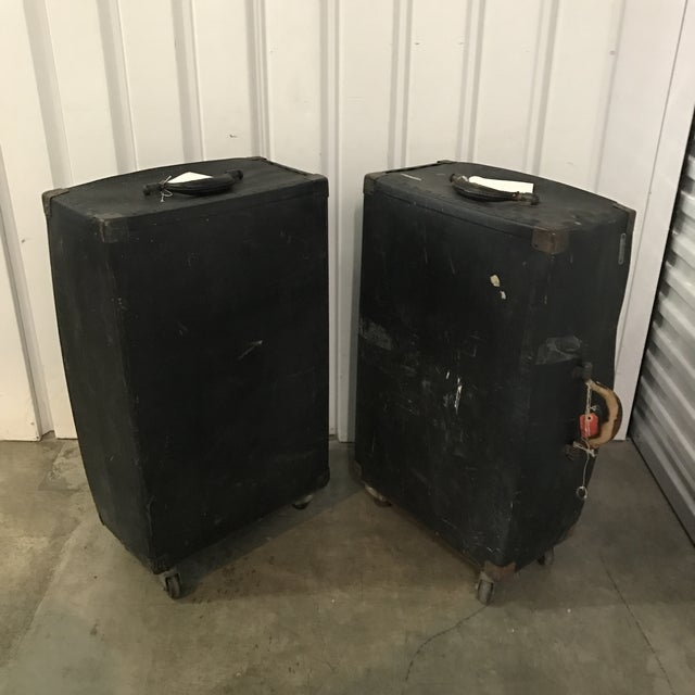 Pair Of Vintage Black Trunks On Rollers. Maker sticker Fibre products NYC.
