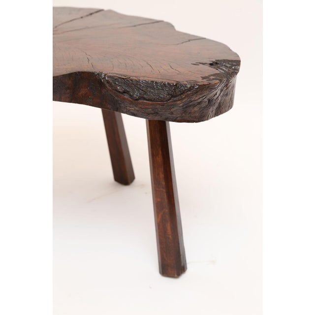 Vintage tree trunk table with natural edge from the cross-section of a tree trunk. Purchased in Belgium, this table is...