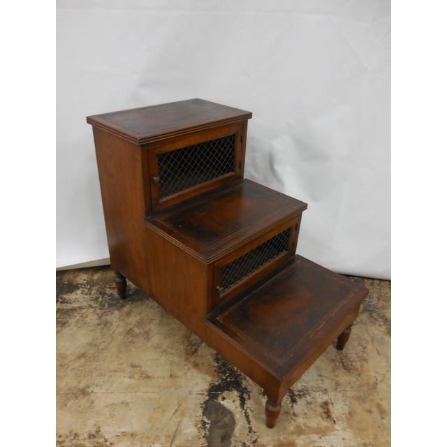 19th Century Library steps/sidetable. Three steps with original embossed leather, two doors with chicken wire set on four...