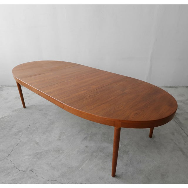 This a beautiful Oval shaped Danish teak dining table by Harry Ostergaard for A/S Randers is both classic in Danish design...