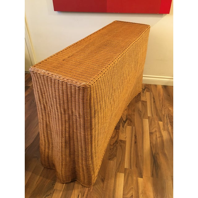 From Modcabana. Mid century modern vintage wrapped wicker Tromp L'Oeil console table. This handmade wicker table is in...
