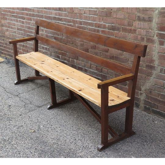 Antique English (c. 1900) pine chapel bench with original stained finish and waxed pine seat.