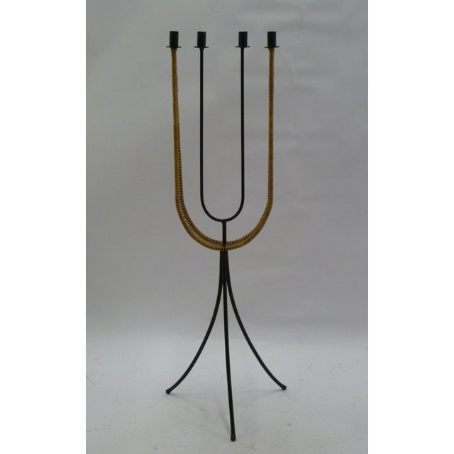 REDUCED FROM $1,500. In his unmistakable panache and style, Arthur Umanoff created this standing candelabra in black...