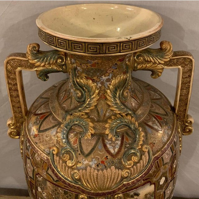 Satsuma thousand face vase or urn palace sized twin handled 35.5 inches high having a gilt Greek key designed rim.
