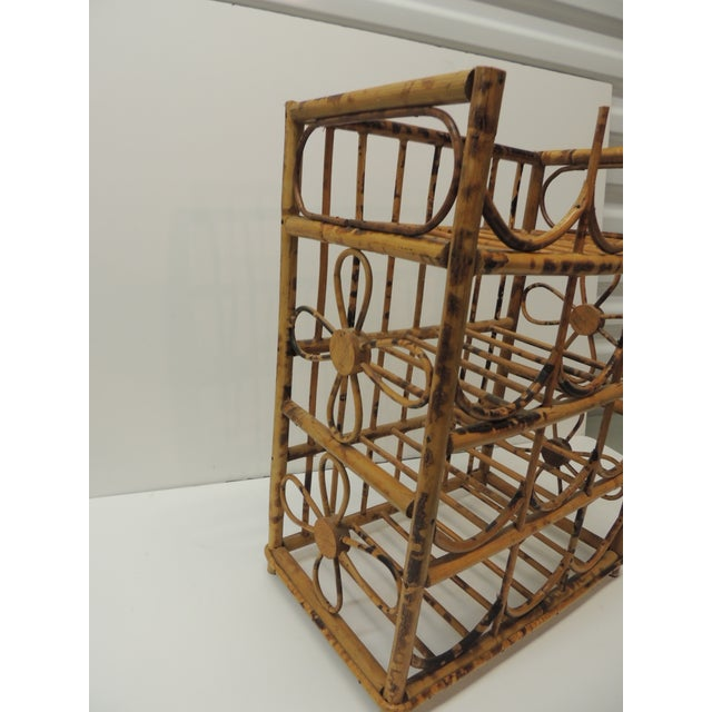Vintage faux tortoise bamboo wine rack. Holds 12 bottles, nice woven flower design on the side panels. Size: 13.5 W x 8.5...