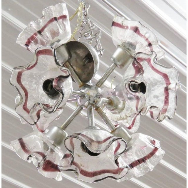 Chrome metal with art glass shades.