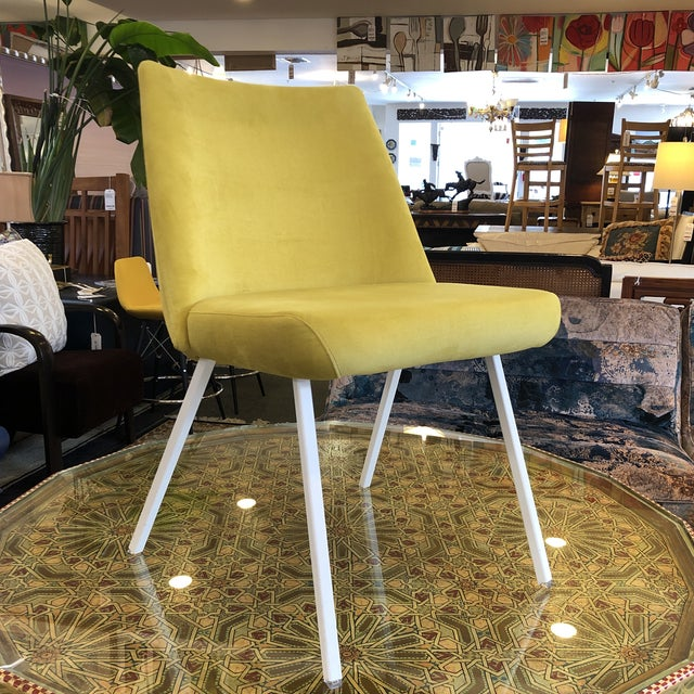 Design Plus Gallery presents the NEW Lola Chair by Trica Furniture. The yellow chair's modern curves are outlined in self...