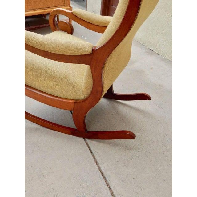 Swedish period Biedermeier rocking chair rendered in birch wood. In original fabric. In excellent structural condition....