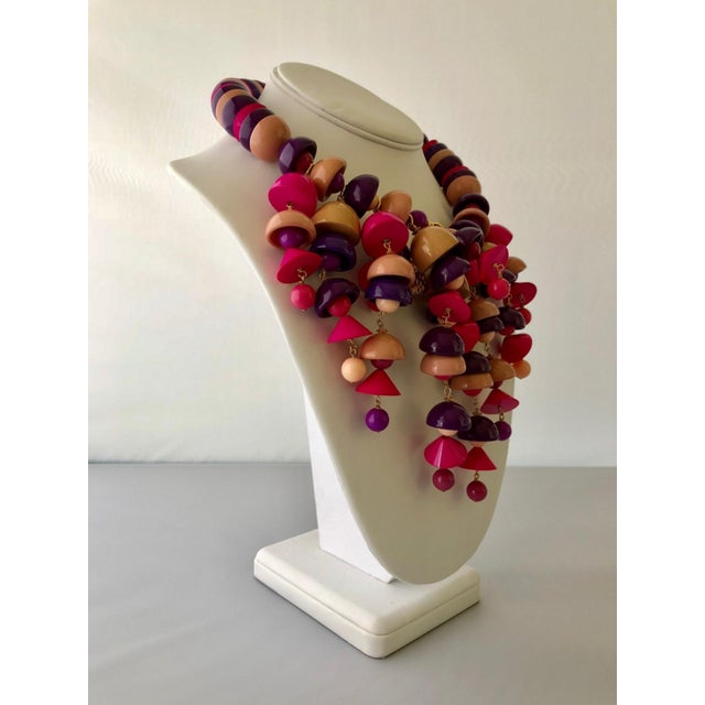 Unique French architectural fringe statement necklace comprised out of vintage mauve, pink, coral and purple Galalith...