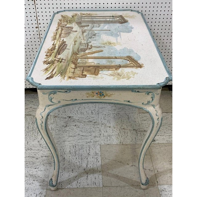 Venetian painted table or desk, of rectangular form with hand painted Capriccio scene of the Roman Forum, raised on four...