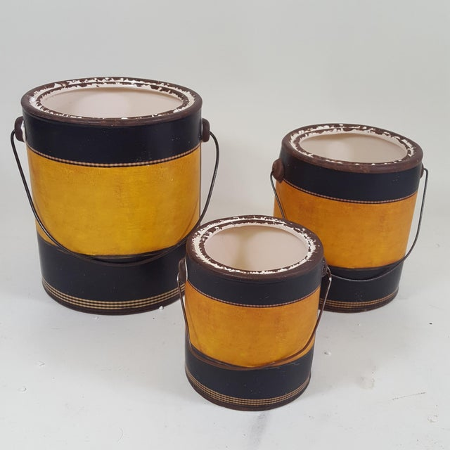 This set of canisters are new and were designed to look like old paint cans with labels that look like old fashioned...